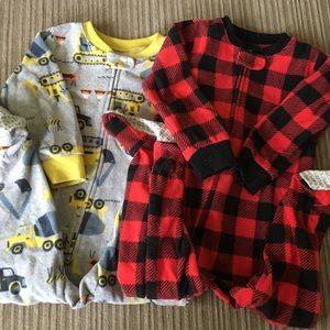 2 Carter's footy pajama sets in size 18 month